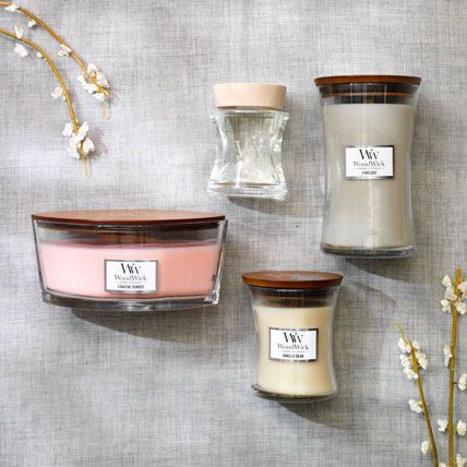 three woodwick candles and one spill-proof fragrance diffuser in various scents and sizes
